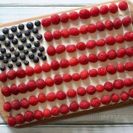"Red, White and Blue fruit ""pizza"" is more like a cookie bar, topped with cream cheese frosting and fruit – The perfect 4th of July dessert!"