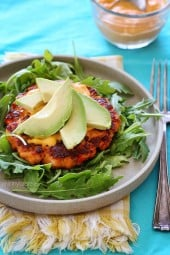 Some burgers are just meant to be eaten without a bun. These salmon burgers are the perfect example. So much flavor in these burgers made with wild salmon, served on a bed of arugula with sliced avocado and a spicy sriracha mayo – a bun would only disguise it.
