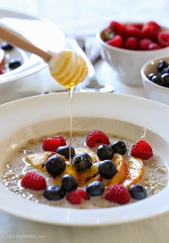 These Summer Quinoa Breakfast Bowls are my favorite! Served as a warm cereal topped with fresh fruit and a drizzle of honey. A healthy protein packed breakfast.