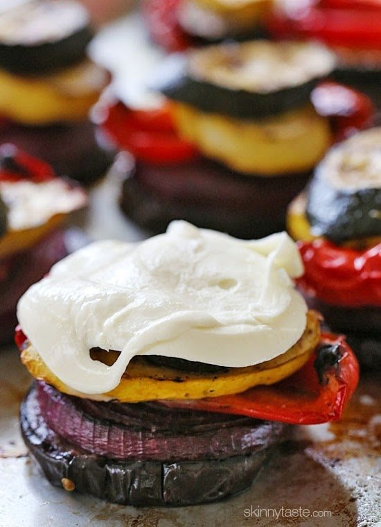 Grilled Vegetable Towers with Mozzarella are layered with grilled, marinated eggplant, zucchini, yellow squash, red onion and bell peppers topped with fresh mozzarella.