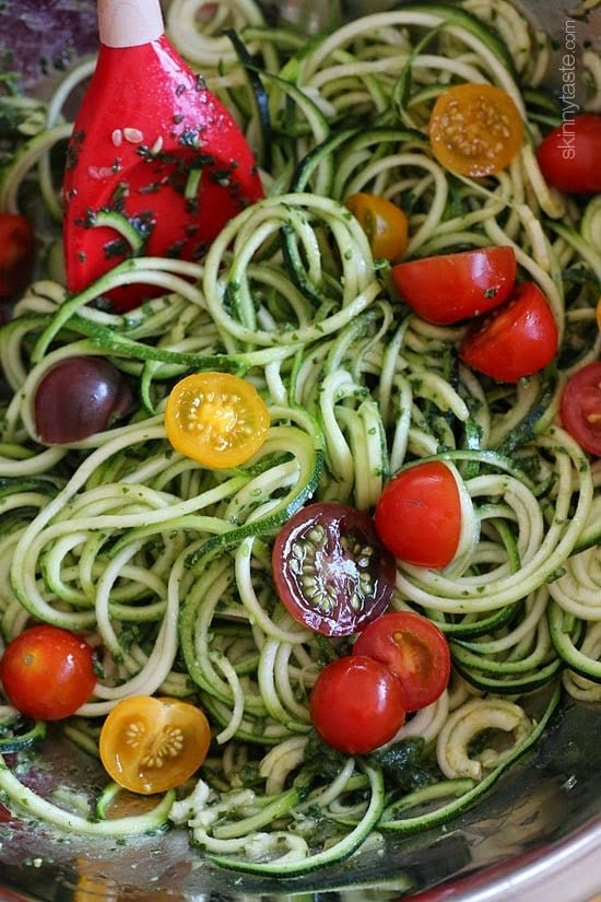 Raw Spiralized Zucchini Noodles with Tomatoes and Pesto is my favorite easy, end-of-summer vegetarian dish made with raw, garden vegetables and homemade pesto.