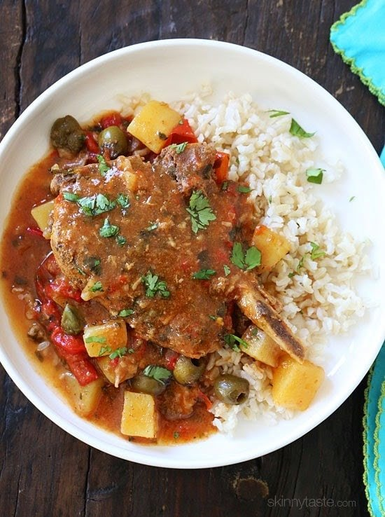 These slow cooker pork chops are seasoned with Latin spices in a flavorful sauce with tomatoes, olives, peppers and potatoes. They literally fall of the bone when they come out of the slow cooker!