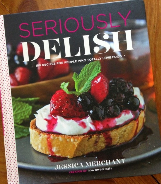 A cookbook titled Seriously Delish with a picture of french toast with whipped cream and berries on the cover