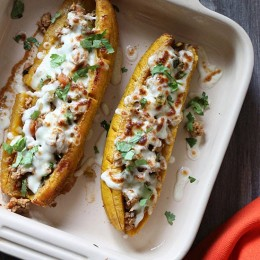 These sweet plantains are baked in the oven and then stuffed with a savory turkey picadillo filling and topped with cheese – pretty hard to resist!