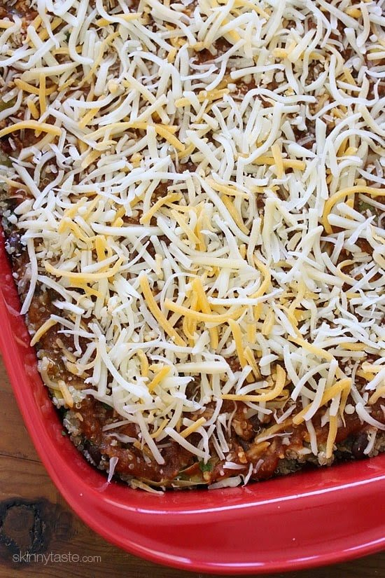 Quinoa Fiesta Enchilada Bake made with quinoa, black beans, corn, cilantro and green chiles topped with a quick homemade enchilada sauce and cheesy goodness!