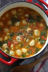 Mini Turkey Meatball Vegetable Soup is kid-friendly and perfect to warm up to on a chilly autumn night. It's made with mini turkey meatballs, tomatoes, zucchini, carrots, spinach and my secret ingredient for the best tasting soup – a parmesan cheese rind. I always keep the rinds in my freezer just for making soup, so don't throw them out!