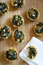 These bite-sized spinach pies are a fun twist on one of my favorite Greek dishes, Spanakopita. These are great appetizers for the Holidays, football games, or anytime you get together with friends and family.