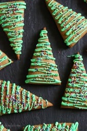 These Gingerbread cookies are made with a fraction of the butter – yet they still have the same great flavor and texture. This year I wanted to make them into Christmas trees. No cookie cutter required, all I used was a knife to cut them into triangles!