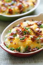 Creamy mashed cauliflower with cheese and bacon made with a touch of whipped butter, buttermilk, garlic and herbs and topped with cheese and bacon – low-carb, but you'll swear it's loaded with tons of calories!