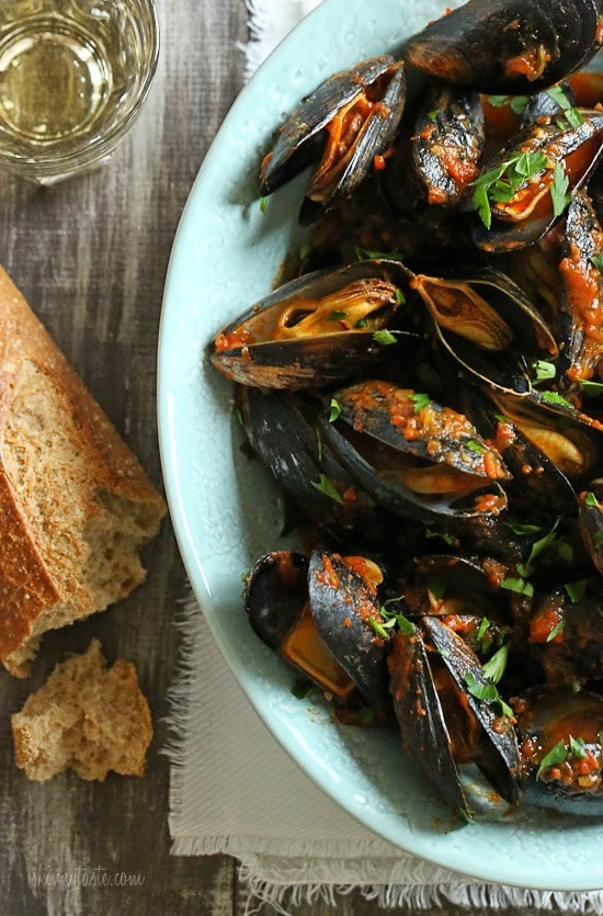 Mussels in a spicy red marinara sauce – simple and elegant, best served with lots of whole wheat crusty bread for dipping into the delicious sauce.