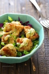 Bangin Good Chicken Salad is delicious, made with tender chunks of breaded chicken baked until golden topped with delicious Bang Bang sauce. I served this over mixed greens and swooned with every bite!