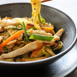 This faux lo mein dish is made with zoodles (zucchini noodles) in place of noodles and the results are DELISH (and bonus under 300 calories)! Each bowl is loaded with chicken and vegetables in a savory sauce. If you want to make this meatless, tofu would also be great in this dish. Start to finish this takes about 20 minutes to make... quicker than waiting for your take-out to get delivered!