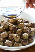 These mini meatballs, made with a combo of lean ground beef and spicy turkey sausage are browned in a skillet (or you can bake them) then finish cooking in the slow cooker. After they are cooked, you pour a delicious honey-lime sauce over them and watch them disappear!
