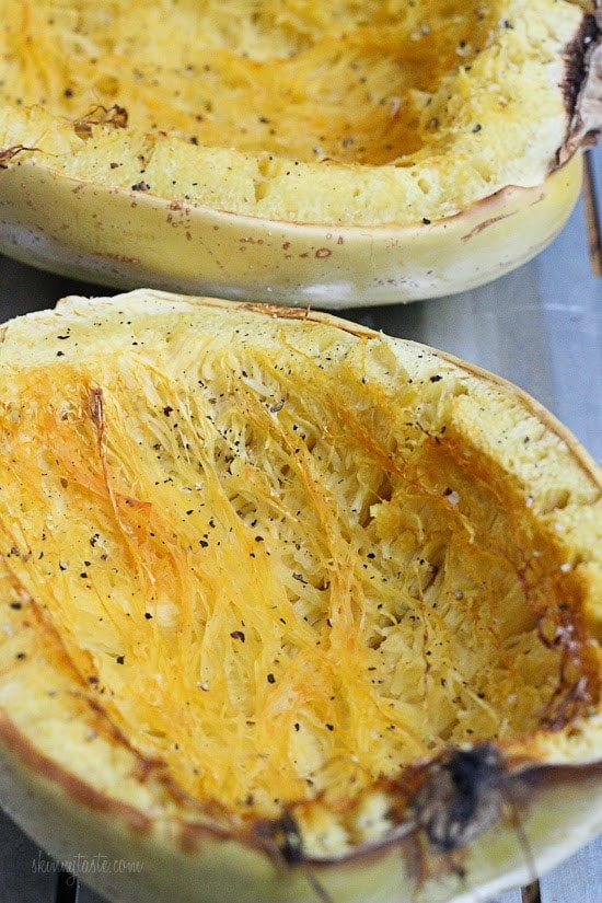 Two roasted halves of spaghetti squash