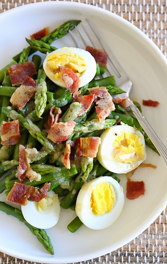 Asparagus Egg and Bacon Salad with Dijon Vinaigrette is the perfect easy Spring salad made with just a few simple ingredients – asparagus, hard boiled egg and bacon tossed with a Dijon vinaigrette.