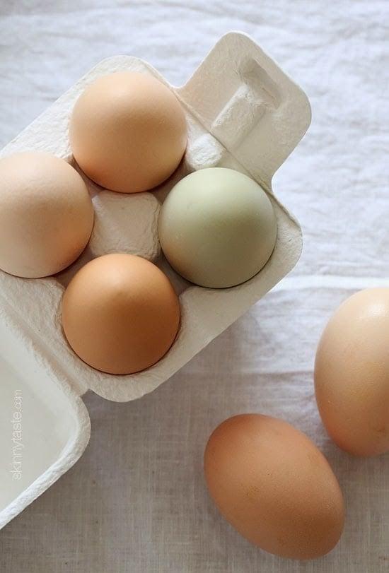 Fresh farm eggs of varied color.