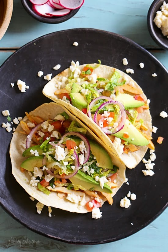Grilled Chicken Tacos with Lettuce Slaw, Avocado and Cotija