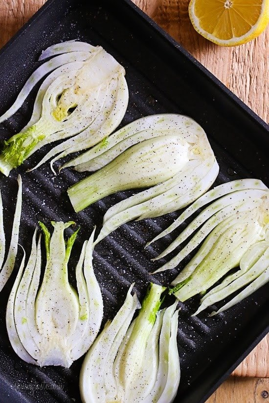 Grilled fennel with lemon, olive oil and shaved parmesan is my FAVORITE way to eat fennel. If you think you're not a fennel fan, this is the recipe that may change your mind!