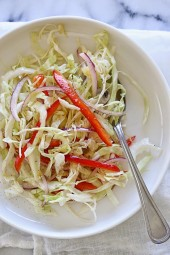 This quick, simple slaw is a staple in my house. Perfect when you need something acidic to balance a savory dish. Everyone loves this, including my toddler only for her I leave out the red onion. It's also low-carb, vegetarian, gluten-free and whole30 compliant.