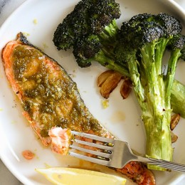 Harissa is one of my go-to sauces for adding a quick burst flavor to any ingredient. You can put it on veggies, meats, seafood, and eggs and even use it as a dipping sauce. For this recipe, I literally just smothered the harissa on top of the salmon with a little lemon zest and put it in the oven.