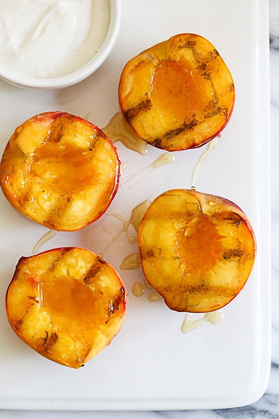 Nothing says summer like biting into a juicy peach. Grilling them is a simple way to enjoy them as a dessert, a perfect ending to a backyard BBQ without heating up your kitchen. Delicious topped with yogurt and honey, but also great topped with low fat ice cream.