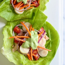 Here's a tasty way to transform ordinary canned tuna into a delicious lunch. These low-calorie, low-carb lettuce wraps are filled with hearts of palm, tomatoes, carrots and onion and topped with a light avocado dressing.