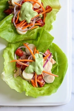 This low-calorie, low-carb tuna lettuce wrap with avocado yogurt dressing transforms ordinary canned tuna into a tasty light lunch filled with hearts of palm, tomatoes, carrots and onion.