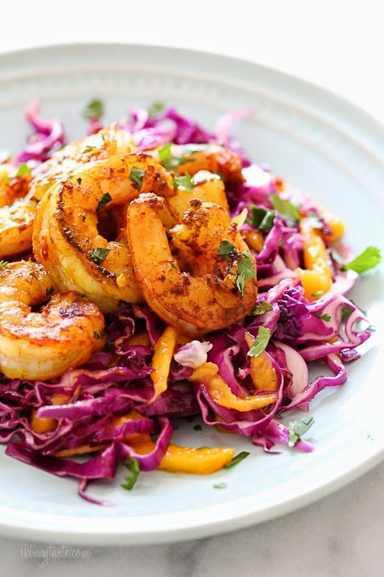 Turmeric-Garlic Shrimp with Cabbage-Mango Slaw – the perfect balance of spicy, savory, sweet and sour, and ready in less than 30 minutes. Weight Watcher 6 points, low-carb, whole30, paleo and gluten-free.