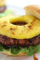 If you're looking for a new way to enjoy a burger, then I think you'll love this Hawaiian inspired teriyaki burger made with lean ground beef, carrots, scallions and topped with a homemade pineapple teriyaki sauce and a grilled pineapple.