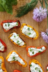 These mini peppers are grilled until slightly charred and filled with an herb cream cheese. A great appetizer to make for the summer!