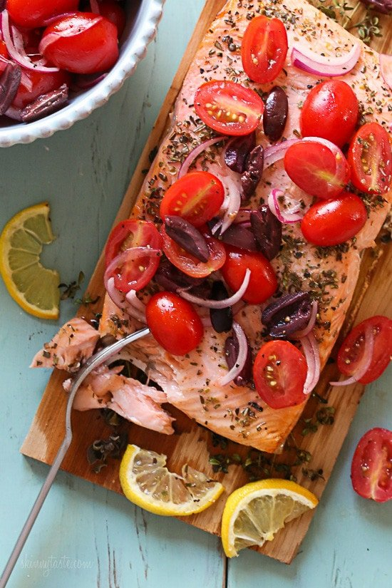Grilled wild Mediterranean cedar plank salmon topped with tomatoes, kalamata olives and red onion.