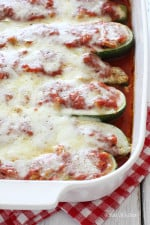 Sausage Stuffed Zucchini Boats are perfect for summer, stuffed with lean Italian chicken sausage, then topped with marinara sauce and mozzarella cheese.