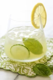 With the holiday weekend coming, if you're looking for a signature cocktail that looks like it jumped right off a spa cuisine menu for under 140 calories, this is it! Made with muddled cucumbers, basil, lemon juice, gin and a splash of seltzer, it's light and summery and perfect to serve at your next party.