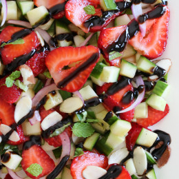 This easy light summer salad, made with cucumbers, strawberries, almonds and fresh herbs is great alongside grilled chicken, fish or for a light lunch you can double the serving and add some goat cheese to the mix or serve it over quinoa for more protein.