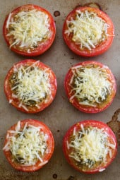 Juicy, delicious roasted tomatoes topped with pesto and shredded Parmesan cheese. So easy to make, only 3 ingredients!