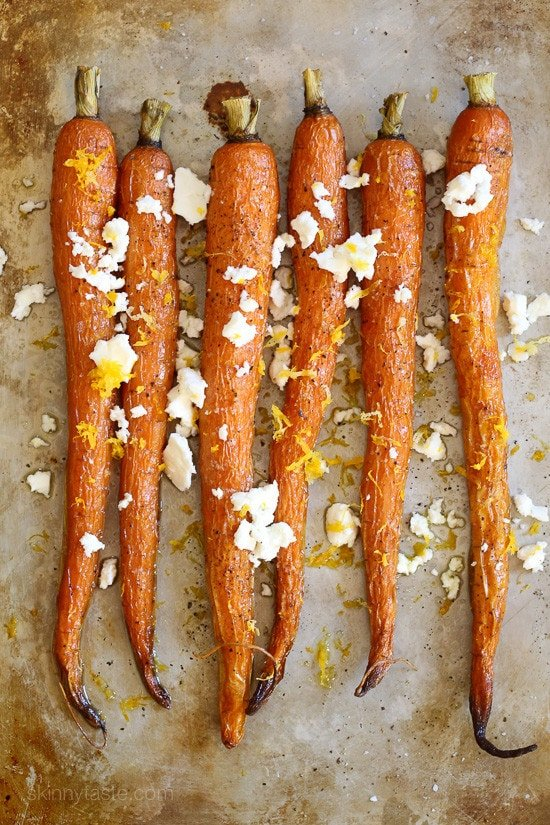 Roasted carrots drizzled with a little oil and finished with Feta, a drizzle of truffle oil, fresh lemon and lemon zest. My FAVORITE way to eat carrots!