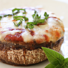 Veggie Lasagna Stuffed Portobello Mushrooms, stuffed with spinach, bell peppers, cheese and marinara sauce – a delicious meatless meal that's low-carb and pretty genius!