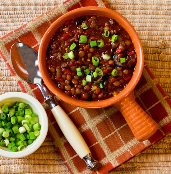 Vegan Lentil Chili with Roasted Red Peppers, Olives and Green Onion