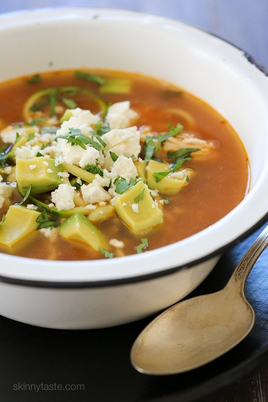 "Tender-crisp veggie noodles make a wonderful low-carb pasta replacement in this delicious, Latin inspired Chipotle Chicken Zucchini ""fideo"" soup combined with bright fresh cilantro, creamy avocado and some crumbled queso fresco on top."
