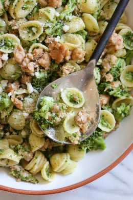 Orecchiette Pasta with Chicken Sausage and Broccoli is one of my favorite weeknight pasta dishes, a real crowd-pleaser, and my husband even goes back for seconds. This is the only way I can get Madison to eat broccoli, I cook the pasta and broccoli at the same time all in the same pot, which creates a pesto-like broccoli sauce the kids can't pick out (trust me, it's so good!).