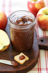 Apples are slowly cooked in the crock pot with sugar and spices, caramelized to make this sweet thick dark apple preserve (like a spreadable apple pie) that's great on toast, stirred into your oatmeal, Greek yogurt or cottage cheese, served over pancakes or biscuits, graham crackers, etc, and for savory dishes such as roast pork or on a sandwich. Grilled turkey and brie sandwiches with apple butter is a favorite!