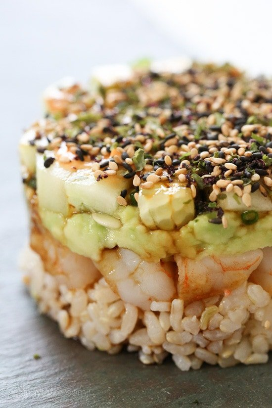 These EASY, Spicy California Shrimp Stacks will satisfy your sushi craving, and they taste SO GOOD! Layered with cucumber, avocado, shrimp and brown rice, then topped with a spicy mayo – YUM!