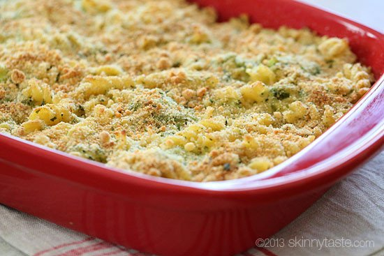A casserole dish of pasta and broccoli with a crunchy bread crumb topping.