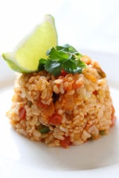 This Quick Mexican Brown Rice is the perfect side dish that goes with everything from tacos, enchiladas, refried beans –you name it!