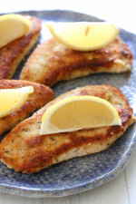 Here's a quick, weeknight dish the whole family will love! Turkey cutlets with a wonderful Parmesan crust lightly pan-fried in just enough oil and butter to make it yummy, without making it greasy and high in calories.