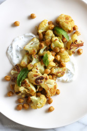 In an effort to still enjoy the flavors yet lighten things up a bit, I decided to create this roasted cauliflower and chickpea dish with minty yogurt. It's great for lunch or as a side dish with dinner.