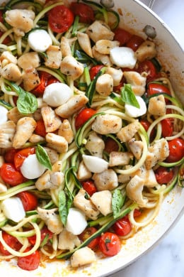 Chicken and Zucchini Noodle Caprese is made with sauteed bite-sized chicken breast and grape tomatoes cooked with spiralized zucchini, fresh mozzarella and basil. An easy, low-carb 30-minute meal!