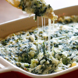 Yeah baby! Bring this hot spinach and artichoke dip to your next party, no one will know it's light! Easy to make ahead then bake when you're ready to eat.