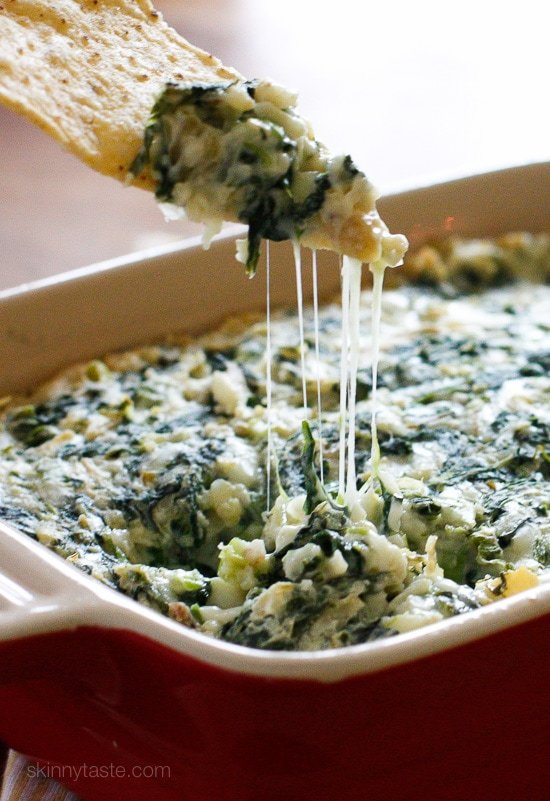 This easy, cheesy, Hot Spinach Artichoke Dip has yogurt to lighten it up.
