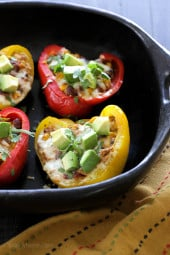 Bell peppers stuffed with my ever-so-popular Crock Pot Chicken Taco Chili and topped with cheese – easy and SO good!I love a recipe that can turn into several dishes to use throughout the month.